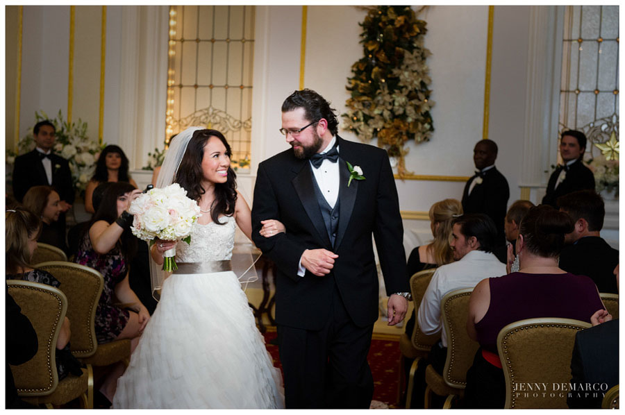 Bride and Groom exit the ceremony inside the Crystal Room at the Driskill hotel