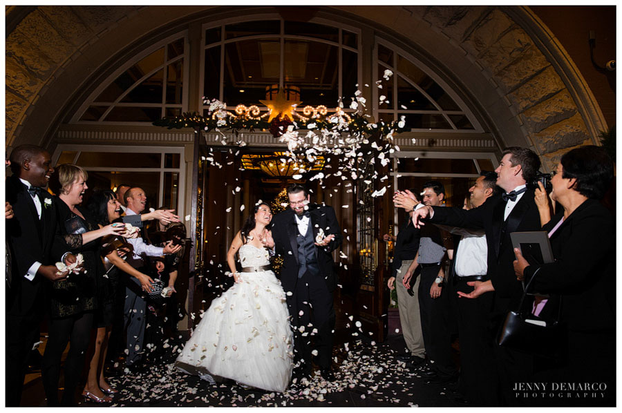 Bride and Groom exit through rose petal toss in front of the Driskill