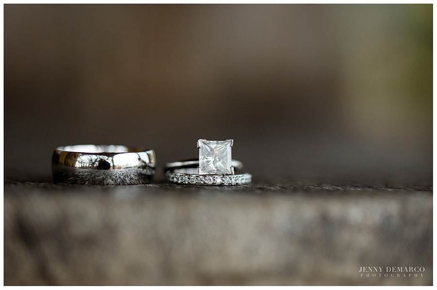 Classy diamond wedding rings from a Hill Country wedding are pictured in this detail shot.