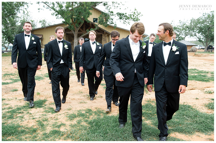 The groom and groomsmen stroll to the Members Lodge.