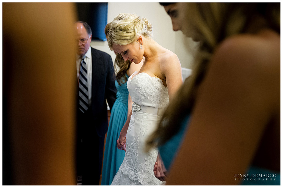 The bride and her family take a moment in the Clubhouse Village.