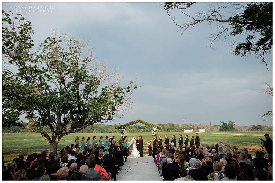 The bride and groom said their vows in a beautiful ranch wedding.