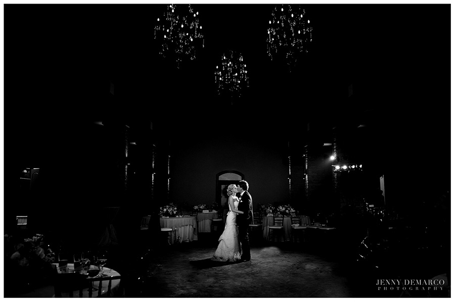 The bride and groom kiss in the empty dance floor at the Country Cottages.