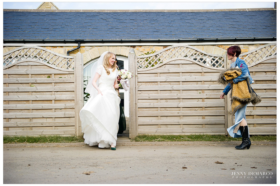 The bride heading to the ceremony as she leaves the cute cottage in which her parents stayed.