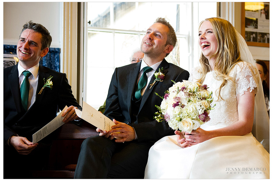 While the officiant was speaking at the ceremony, the couple shared a lovely moment of candid laughter.