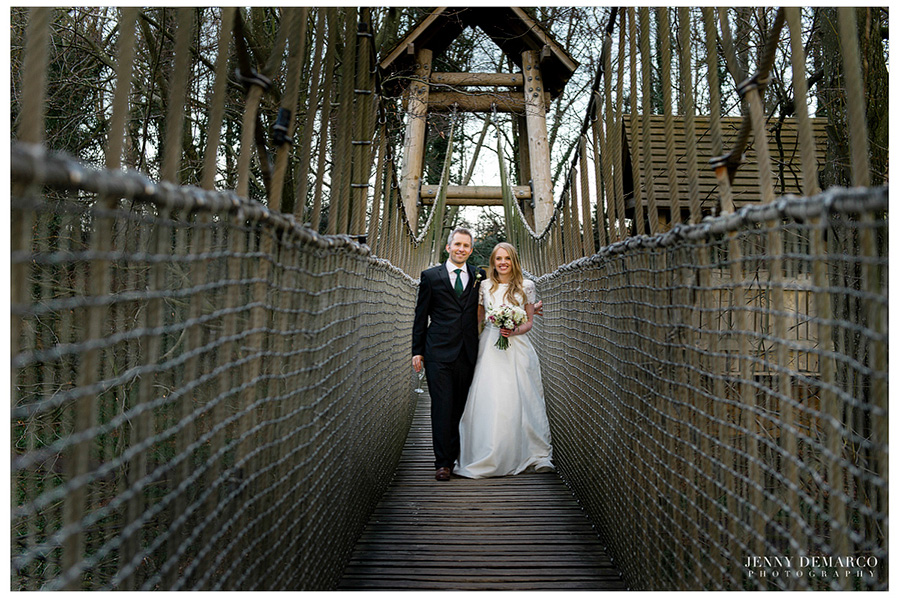 The couple heading to the Treehouse on the wobble rope bridge.