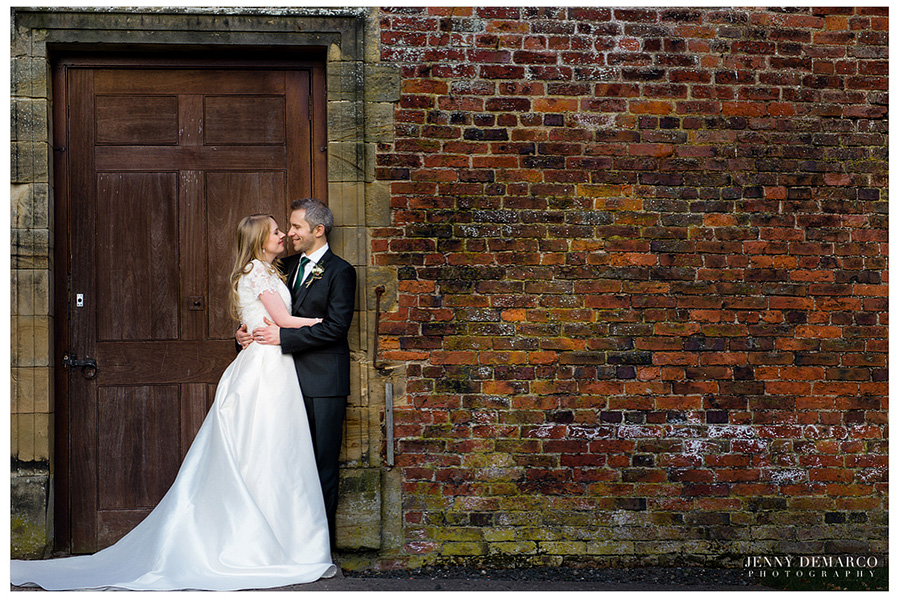 The bride and groom sharing an intimate moment at the Ainwick Castle.