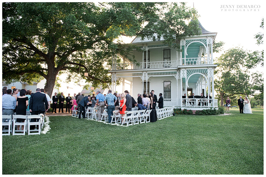 The father of the bride walks her to the ceremony at Barr Mansion.