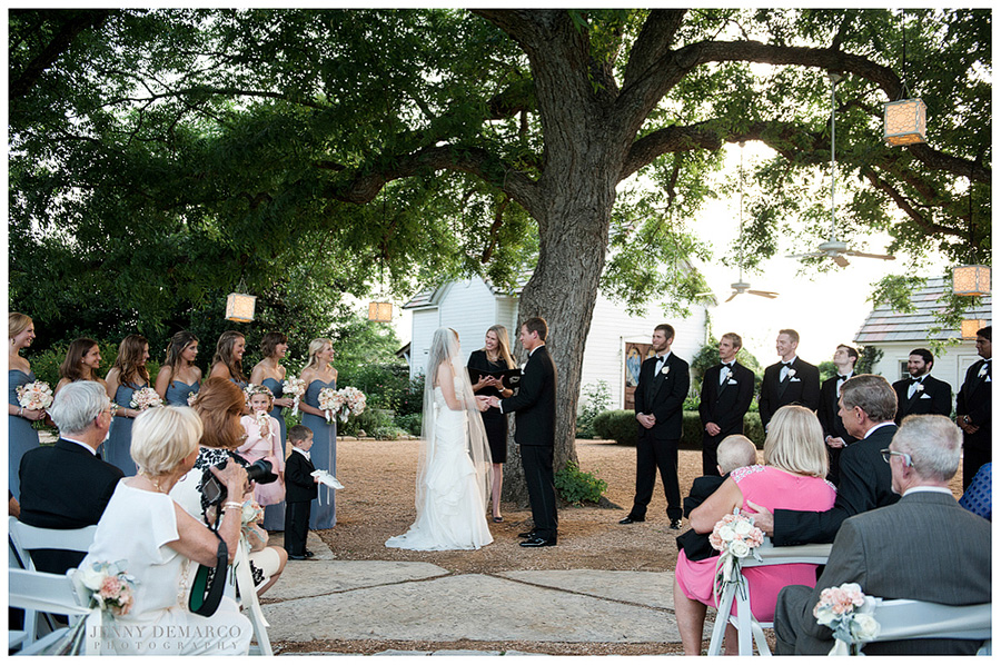 The bride and groom said their vows under a tree at Barr Mansion.