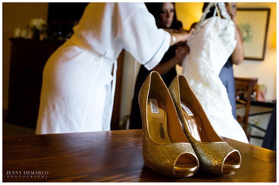 The bride wore posh gold-sequined heels by Badgley Mischka.