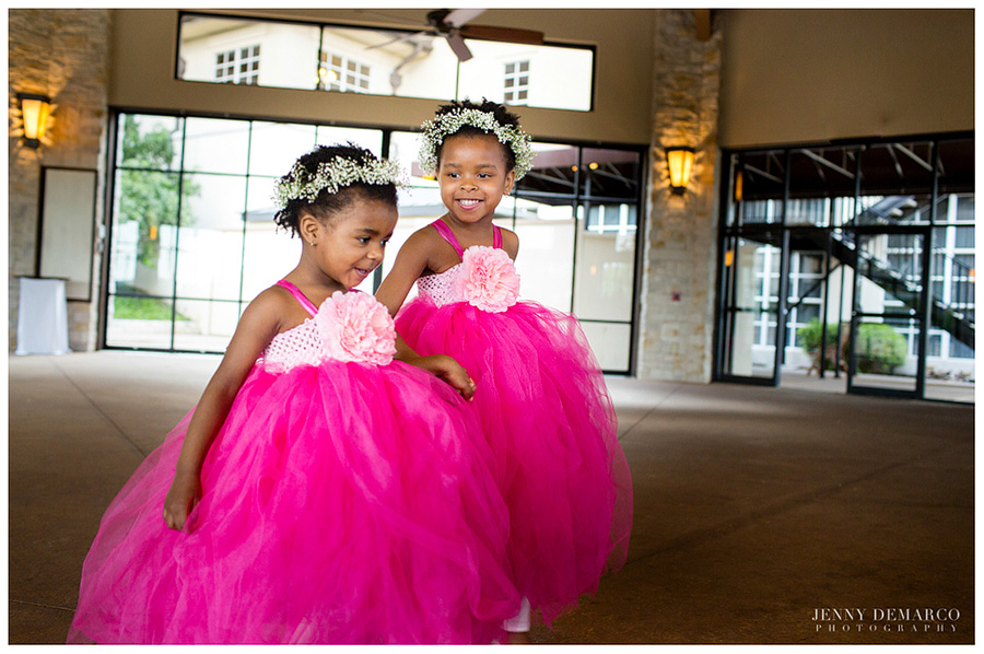 Two cute flower girls wore pink tulle dresses and flowery headbands.