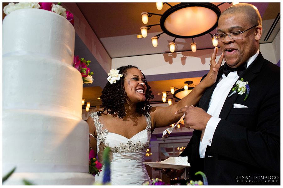The bride smears wedding cake onto the groom at a Barton Creek Resort wedding.