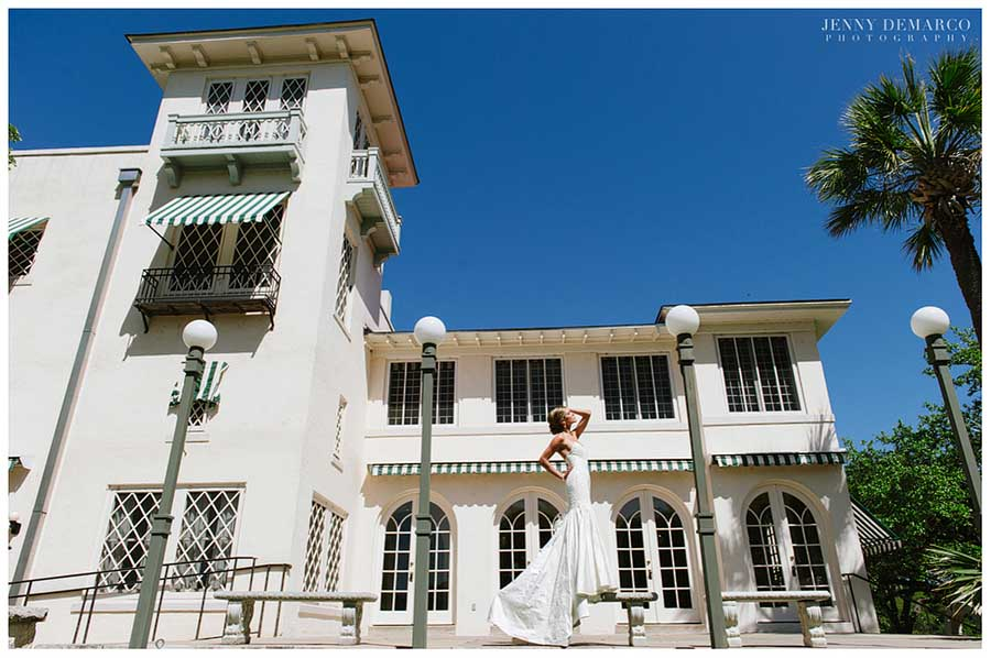Rachel poses in front of Laguna Gloria for her glamorous bridal session.