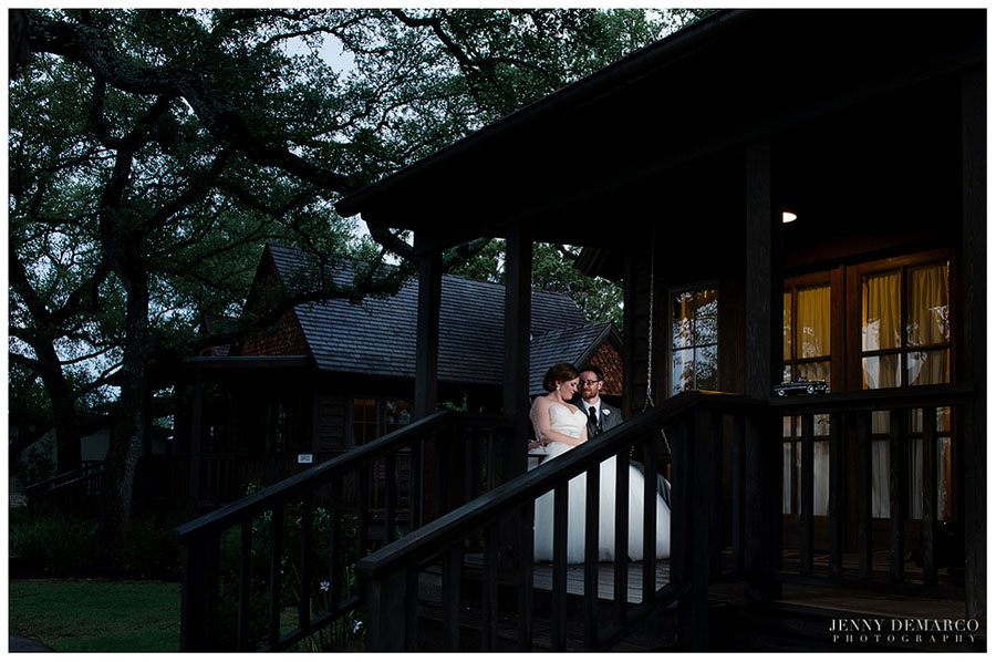 The bride and groom take a special moment for themselves on the porch of the Storybook Bride's Cottage after saying their vows.