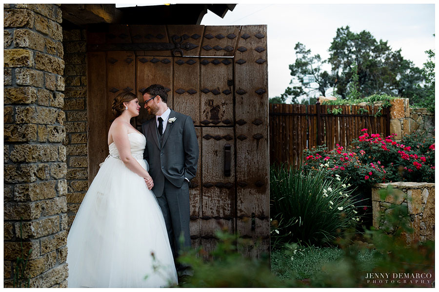 The bride and groom pause for a moment on the Dramatic Open Pavilion made of rare ironwood timbers in Camp Lucy.