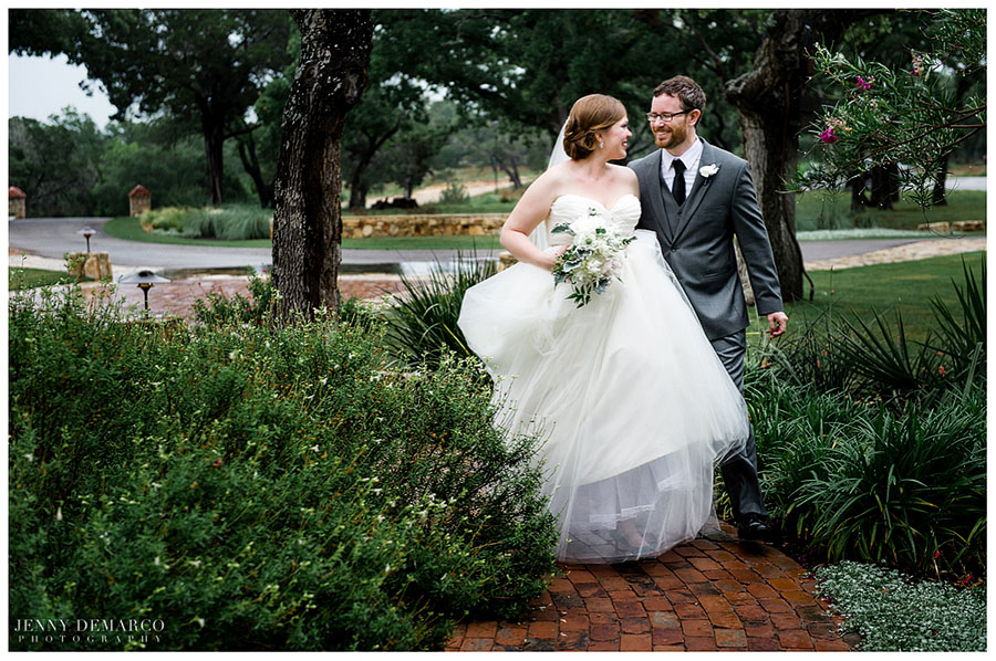 The newly wedded couple walk to the French Colonial Chapel among ancient oaks in a magical ceremony.