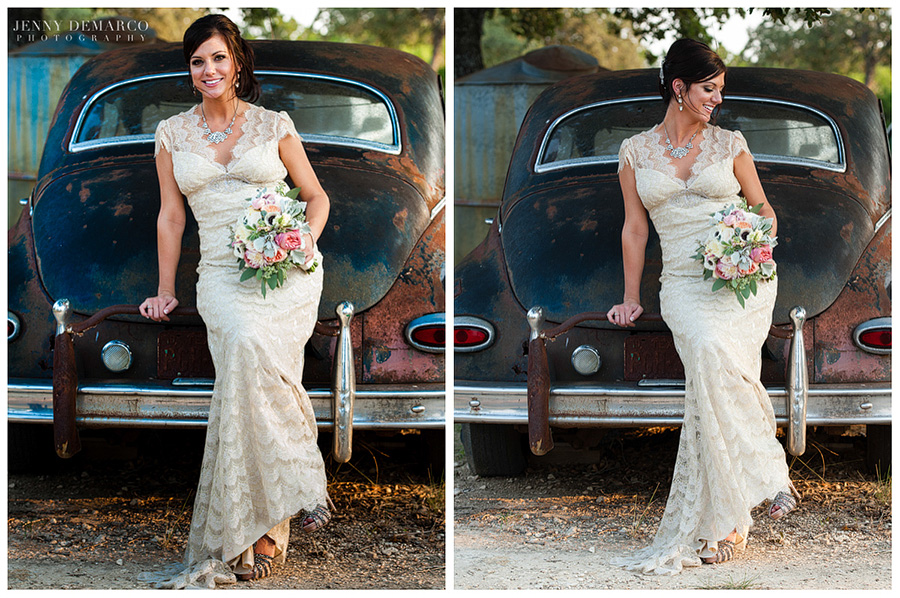 The bride poses for her bridal portraits with her bouqet and lacy gown on a vintage car.