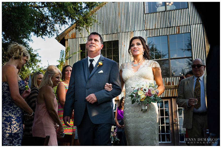 The bride walks up the aisle in her Hill Country wedding.