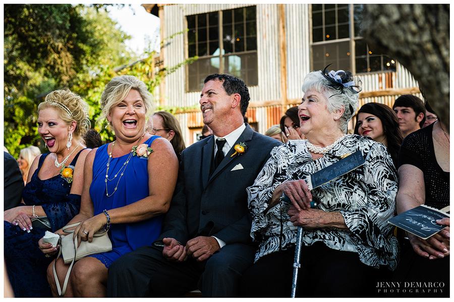 Fashionable wedding guests enjoyed the beautiful wedding ceremony.