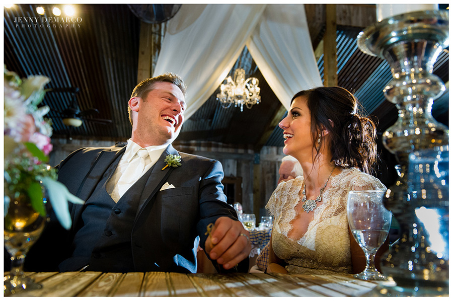 The bride and groom laugh during the fun-filled reception.