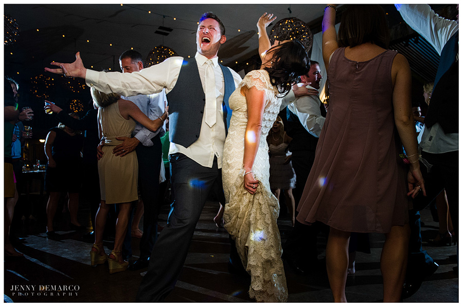 The newly-wedded couple sing and dance during the elegant, fun-filled reception.
