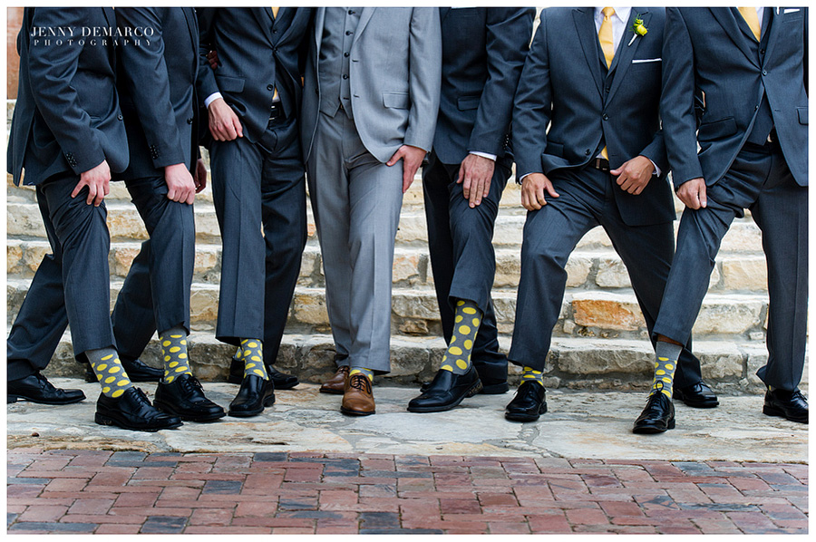 The bridesmaids get lovely yellow flowers, while the grooms wear yellow polkadot socks.