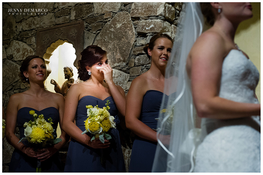 A bridesmaid tears up during the ceremony in Ian's Chapel.