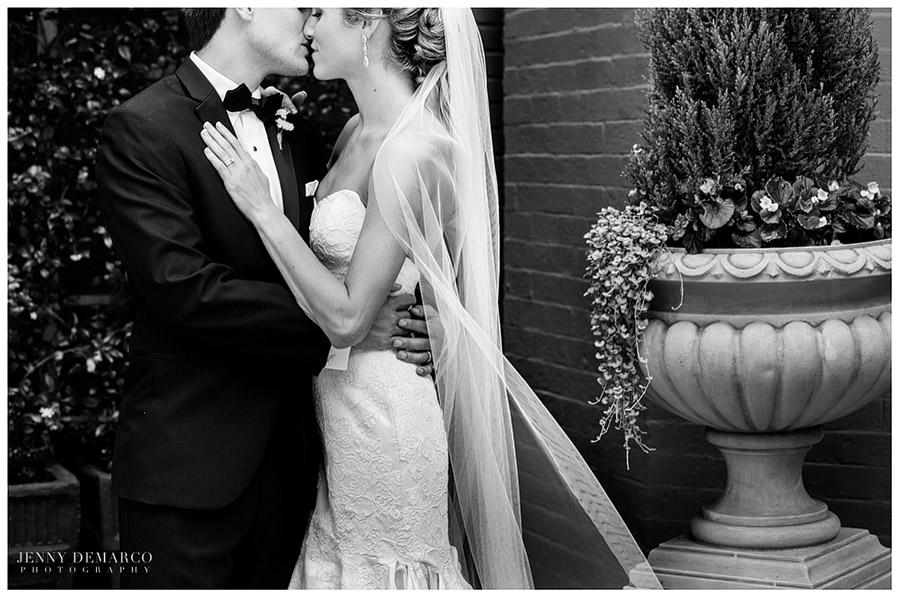 The elegant couple pose outside the Driskill Hotel.