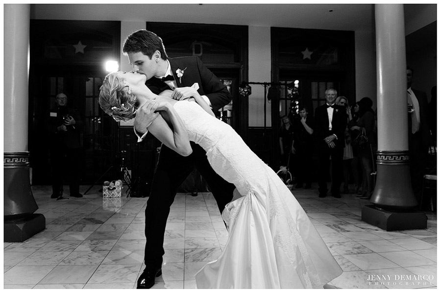 The groom sweeps the bride into a romantic pose during the first dance.