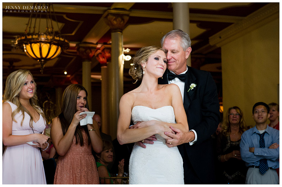 The bride and her father share a beautiful moment during the wedding reception.