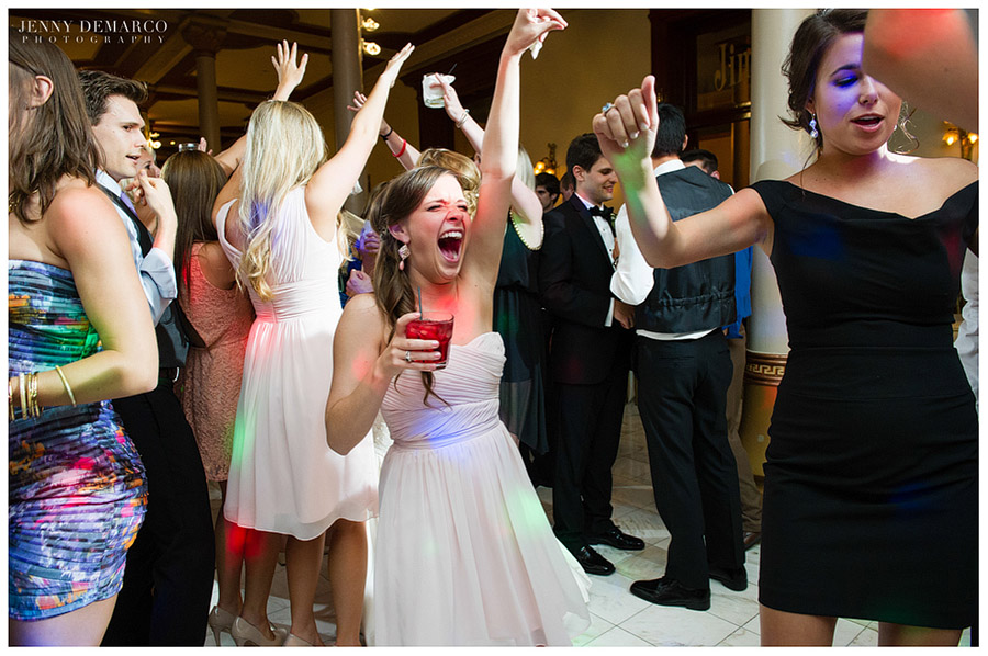 Guests at the wedding reception danced exuberantly in the lobby of the Driskill.
