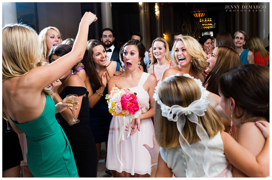 Flamboyant bridesmaids caught the bride's wedding bouquet.