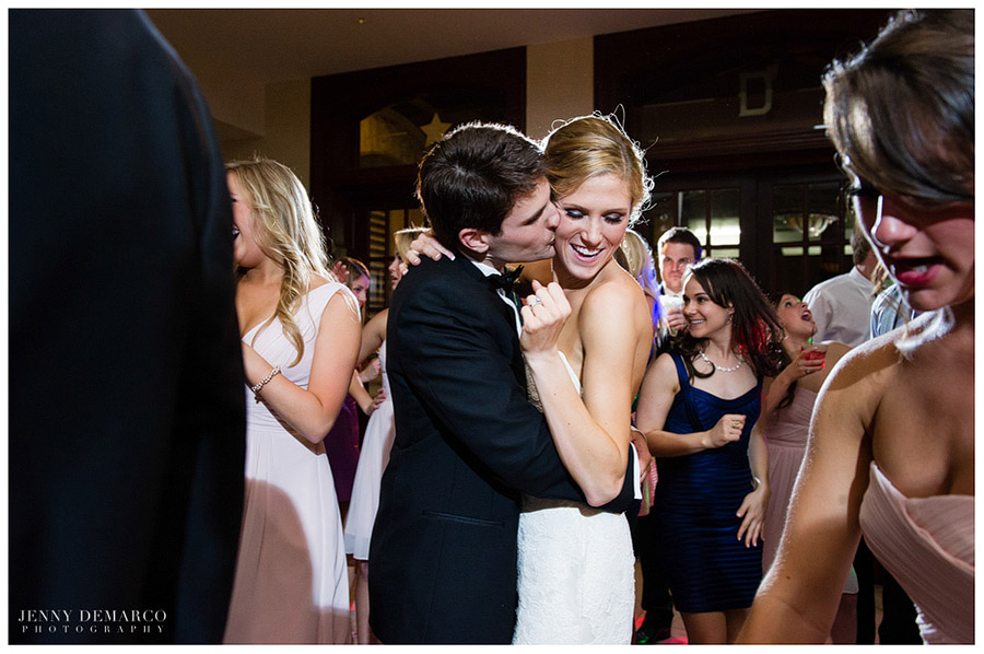 The happy bride and groom dance at their wedding reception.