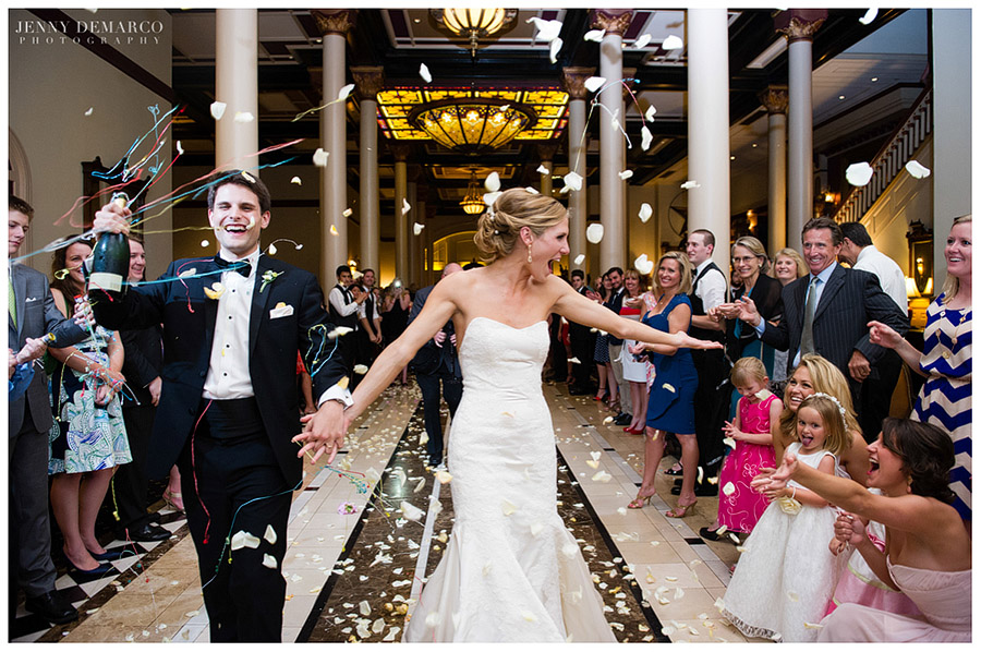 The happy couple walked out in the midst of colorful streamers and white rose petals.