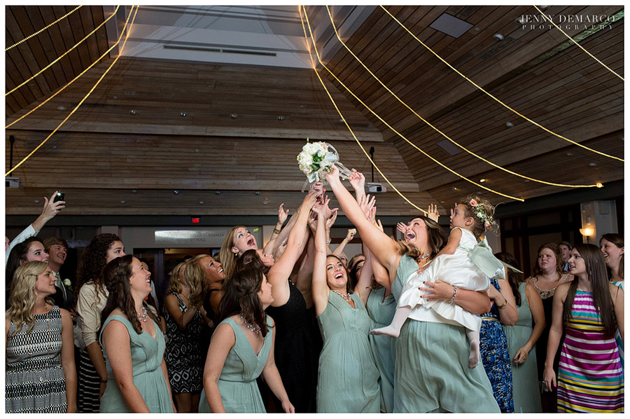 The bridesmaids wore knee-length sage green dresses.