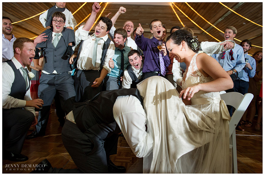 The groom removed the bride's garter much to the hilarity of the reception.