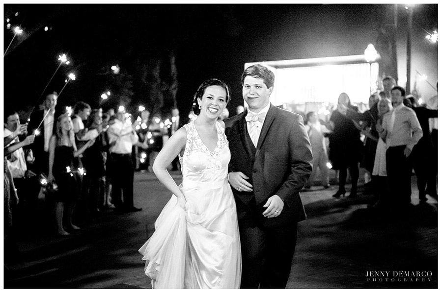 The beautiful bride and groom walked out as guests waved white sparklers.