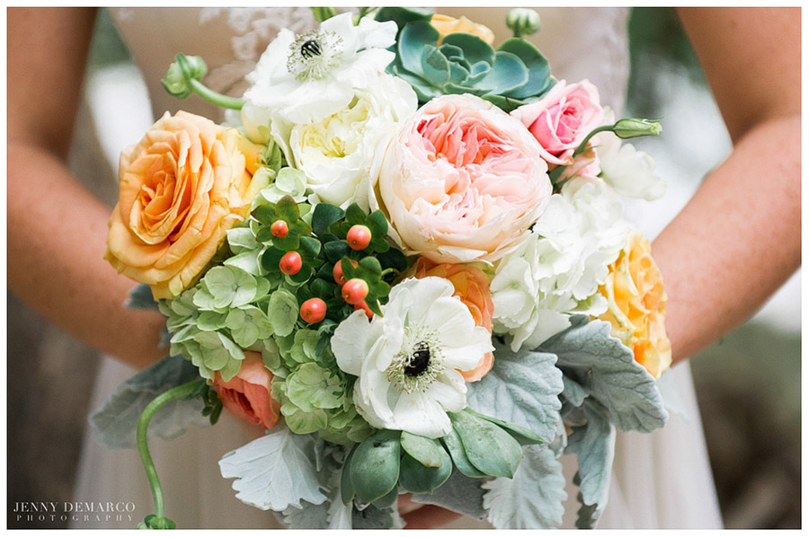 The bridal bouquet featured gorgeous pale pink, peach, green and white flowers.