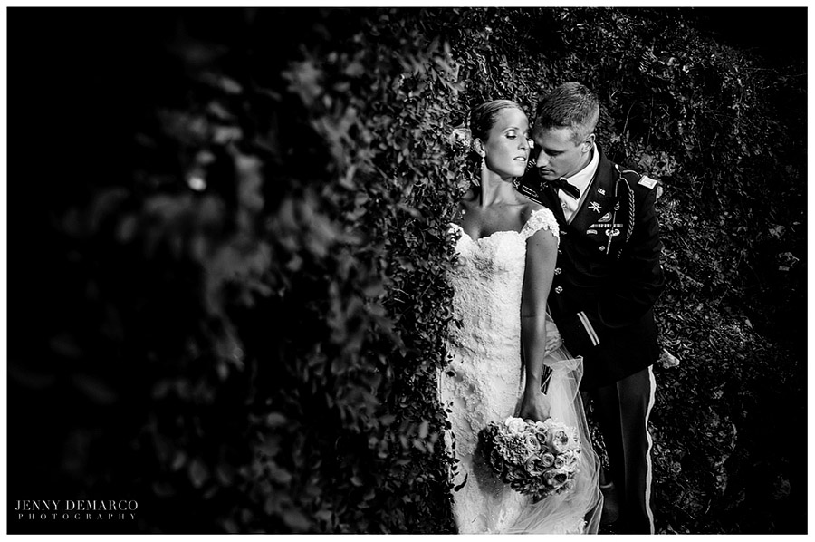 The bride and groom stroll through the exquisite Butterfly Garden.