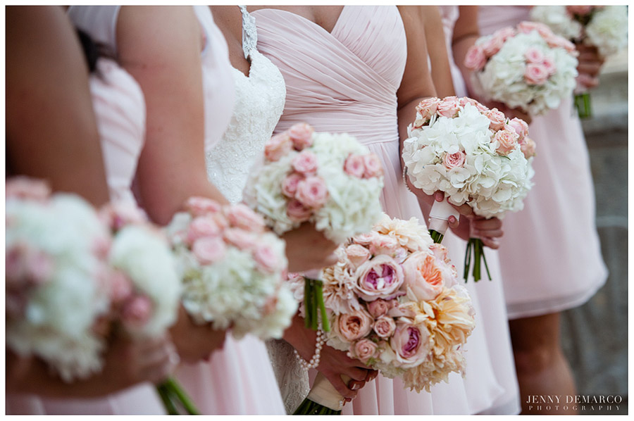 The wedding bouquets had gorgeous pink, peach and white roses.