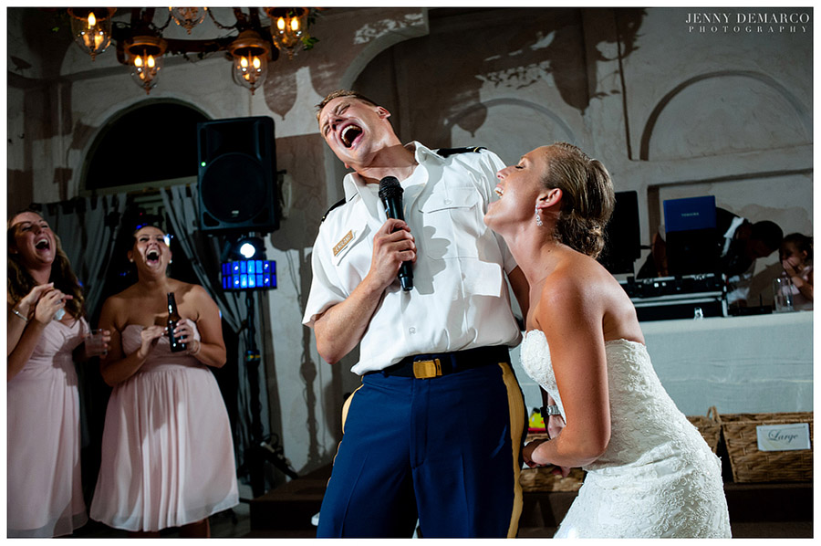 The elegant couple's flamboyant antics at the fun-filled wedding reception made the guests laugh.