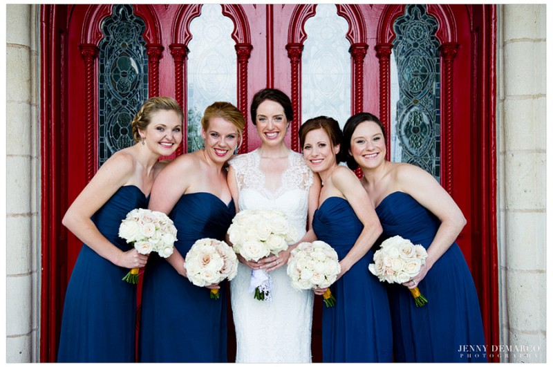 The bride wore a Monique Lhullier gown and her bridesmaids wore Amsale dresses in deep blue. Their bouquets were arranged by Merveille Events.