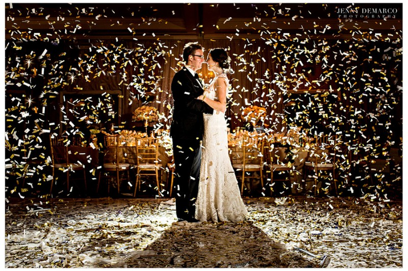 Kate and Kevin embrace in a confetti shower after their wedding reception at the Four Seasons Hotel in Austin, Texas.