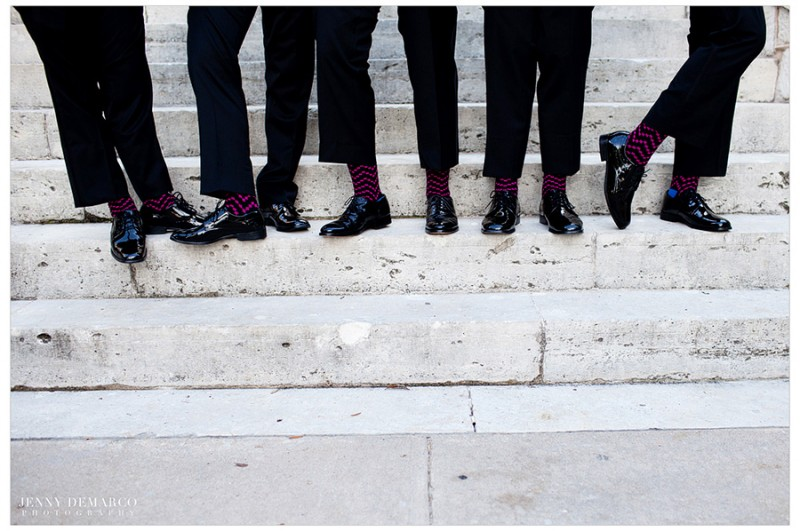 The groom and groomsmen wore Vera Wang Black tuxes with accenting maroon and navy socks.