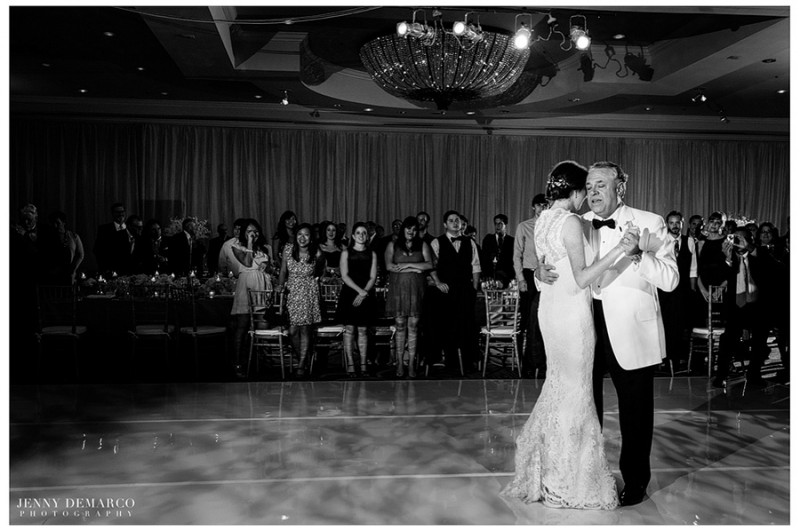 The bride and groom share the father-daughter dance in the main ballroom of the Four Seasons Hotel at their traditional, black tie reception.