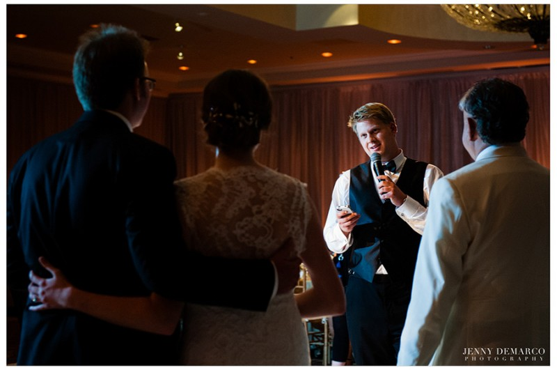 The bride and groom look on as loved ones toast to their new union.