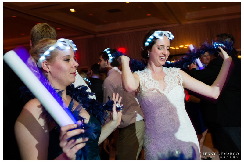 The bride jams on the dancefloor with her guests wearing LED Kayne-style sunglasses.