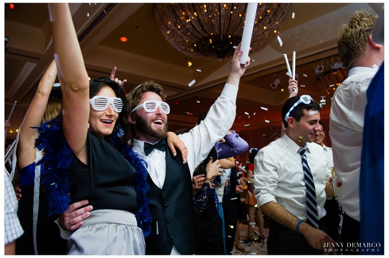 Guests enjoy a confetti shower on the dancefloor in the formal ballroom at the Four Seasons Hotel in Austin, Texas.