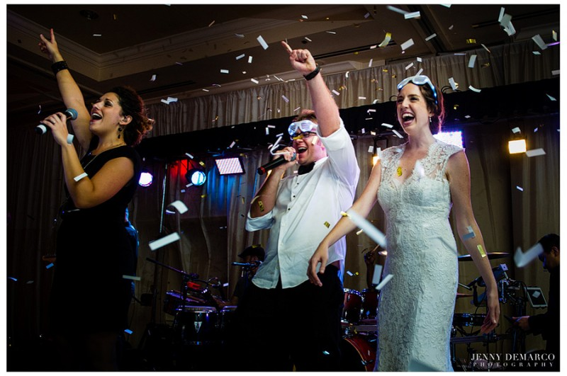 The bride and groom sing on stage to Motown music while being showered with confetti before leaving in a 1968 Bentley.