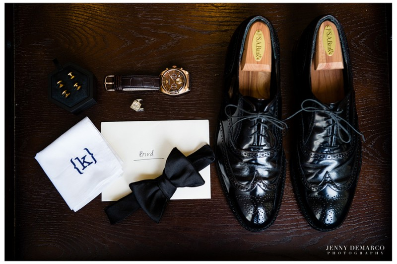 The groom's attire included monogrammed silver cufflinks, a monogramed handkerchief, his late Grandfather's shoes and a Vera Wang tux.